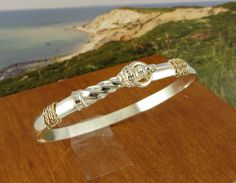 Lighthouse Bracelet Hand Crafted on Cape Cod of Sterling Silver and solid 14k gold. $199.95, via Etsy.