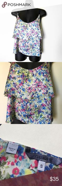 GUESS FLORAL LAYER SLEEVELESS BLOUSE TANK TOP Colorful floral blouse tank top from GUESS. Has 2 layers for a flowy dressy look. Straps are not adjustable, they are a blue thick ribbon like material - very unique. Small gold guess piece on underneath strap. Size small perfect condition! GUESS Tops Tank Tops