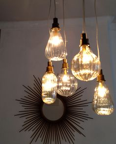 Scalloped glass lighting. I want these for my kitchen