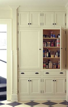 10 Kitchen Pantry Ideas for Your Home - Town & Country Living pantry cabinet. LOVE LOVE LOVE - love the look, the storage & the color - for folk victorian kitchen in our new old house Kitchen Pantry Cabinets, Kitchen Redo, New Kitchen, Kitchen Remodel, Kitchen Ideas, Kitchen Floor, Kitchen Craft, Awesome Kitchen, Kitchen Renovations
