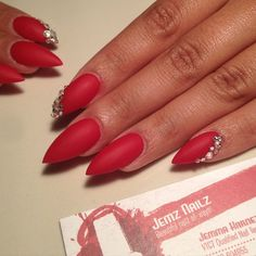 Matte red stiletto nails without  bling