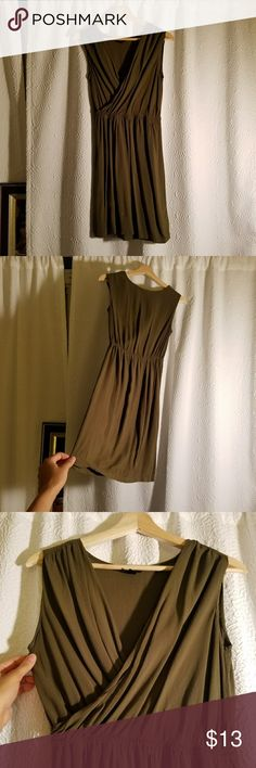 """Olive cross front dress Simple and comfortable olive colored dress in pre-owned condition. In my opinion, the dress is slightly lighter in color than what is shown in the photos. I cannot find any flaws. Hits me right above the knees, I'm 5'4"""". Mossimo Supply Co Dresses Midi"""