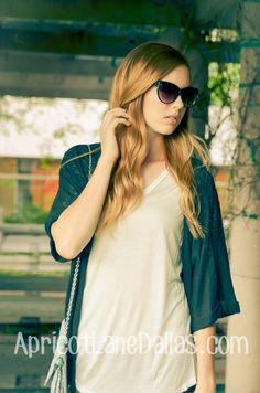 Basic ivory tee, black cardigan, aztec print clutch,  and sunglasses! #fashion #apricotlanedallas
