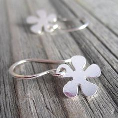 Earrings with tiny daisy flower dangles on handmade sterling silver wires, small earrings, a petite celebration of nature, by Flaunt.