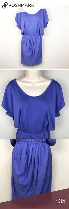 """NWT Soft Joie Blue Cotton Drape Tulip Dress NWT Soft Joie 100% cotton periwinkle blue almost purple elastic waist mini dress with blouson style dolman top and faux wrap tulip skirt. Amazing as a beach cover up with a tan and sandals, or as a tunic with leggings, or even a decadent nightgown. Brand new condition, no flaws. Made in Peru.  Approx 20.5"""" pit to pit, waist is 11.5' laid flat (but elastic so intended to stretch), 35"""" shoulder to hem, 16"""" long from elastic waist to hem in back Soft…"""
