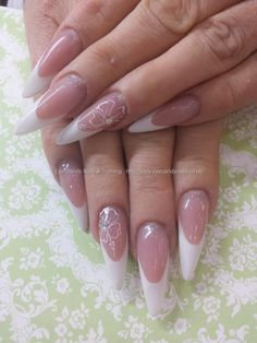 Sculptured white tips with freehand nail art