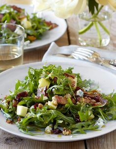 cape cod chopped salad - crisp greens and apples, sweet maple syrup, tart cranberries, salty bacon and blue cheese, and substantial pecans and pine nuts