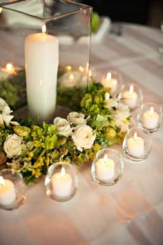@A Practical Wedding: Love the look of a wreath of greenery and buds around the base of a vase or lantern to create a centerpiece, but hoping to find an easy and inexpensive way to pull it off. Quick set up or make ahead needed, so it could be much simpler than what is pictured. #APWhowto