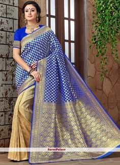 This delightful diva accoutre features unique styling and unusual material. Add grace and charm to your appearance in this beautiful blue banarasi silk traditional designer saree. Look ravishing clad . Indian Designer Sarees, Designer Sarees Online, Exclusive Collection, Saree Wedding, Lehenga, Weaving, Sari, Traditional, Unique