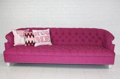 I know it's hot pink but I'm a woman. We like this stuff. Bel-Air Hot Pink Tufted Sofa