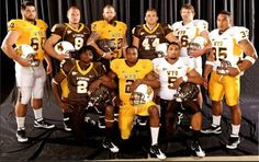 University of Wyoming players pose with the school's new football uniforms on Tuesday in Laramie. The Pokes will have nine different jersey-pants combinations from which to choose. Wyoming Cowboys Football, College Football Helmets, College Football Season, Sports Uniforms, Football Uniforms, Mountain West Conference, Go Pokes, Arizona State, Ronald Mcdonald