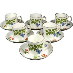 Crown Staffordshire Demitasse Cup  Saucer Set in the lovely Hampton Pattern.  The set includes six cups and six saucers.   The Hampton Pattern has