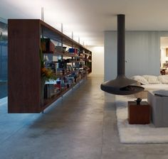 Interior - Isay Weinfeld; floating fireplace and bookshelf