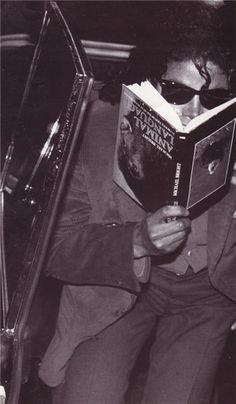 Michael Jackson (Joking around and reading an animal language book upside down) 1988