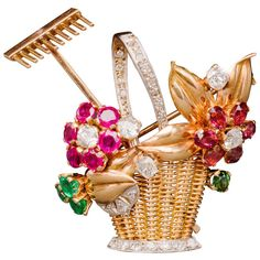 Gem-Set Gold Gardening Flower Basket Pin | From a unique collection of vintage brooches at http://www.1stdibs.com/jewelry/brooches/brooches/
