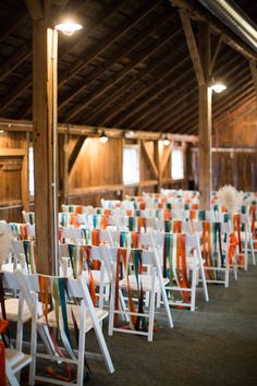 Wedding Ceremony - Rustic Location + White Chairs with Colorful Ribbons for Decor | See more on SMP: http://www.StyleMePretty.com/2014/02/27/the-barn-at-harvest-moon-pond-wedding/ Dani Stephenson Photography