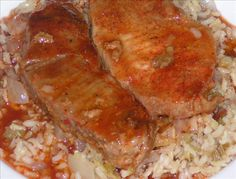 Spicy Baked Pork Steaks from Food.com:   A great way to prepare cheaper cuts of meat! These pork steaks are tender every time, spicy and good! Toss a couple of potatoes in the oven and bake for 15 minutes or so before adding the pork steaks and you have a great meal the family will think you spent more time on than you did!