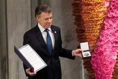 """Colombian President Juan Manuel Santos accepted the Nobel Peace Prize on Saturday, saying it helped his country achieve the """"impossible dream"""" of ending a half-century-long civil war. A smiling . Nobel Peace Prize, Nobel Prize, Al Jazeera English, Le Prix, Impossible Dream, Drugs, Presidents, War, Cool Stuff"""