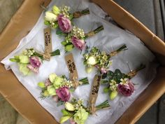 Buttonholes of Freesia, Eustoma, Spray Roses, Waxflower and Eucalyptus www.mrs-umbels.co.uk