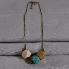 This chic modern asymmetrical geometric Turquoise & Brass 'Cobble Stone' Necklace  for €24.95 from artysmartyshop.com is part of our 'Cobble Stone Street' . With the geometric cubes a reminder of the cobble stone streets at Dublin Castle and the brass name plates outside the Georgian buildings, we have created a piece of the city to wear around your neck! Dimensions: 55cm chain with 3cm extension chain. #artysmartyshop #ladies #fashion #handmadejewellery #winterfastion #trending Stone Necklace, Arrow Necklace, Georgian Buildings, Dublin Castle, Stone Street, Ladies Fashion, Cubes, Handmade Jewelry, Brass