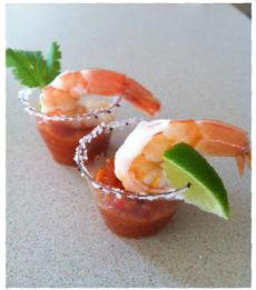 Shot Glass Margarita Shrimp  Zesty shrimp cocktails served in a shot glass rimmed with salt and pepper and a lime garnish
