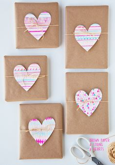 watercolor paper cut into heart shapes attached to paper with twine // gift wrapping ideas