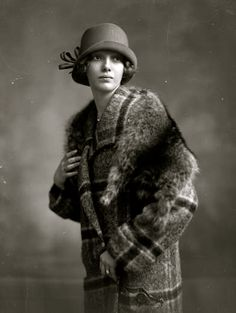 Fantastic coat and cloche hat on this worn by a young woman. Amsterdam c.1923
