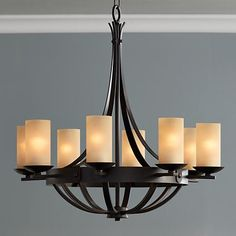 Rustic chic at its best, this bronze finish chandelier features gorgeous scavo glass and an elegant profile.  The handsome design is ideal for use in an entry area or dining room.
