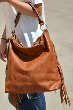 TUULI is a soft big hobo bag in orange cognac natural leather ...