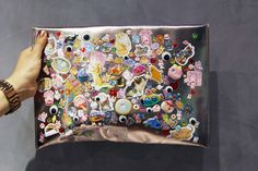 """Susie Bubble posted this photo of a cheap clutch that her sister Louisa Lau covered in all sorts of stickers: """"puffies, glitteries, gellies, flaties, felties."""""""