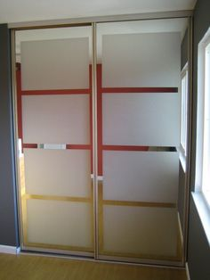 Mirrored Closet Doors: The $25 Makeover! — HGTV - They used the Amorf Frost Tint on old mirror doors!