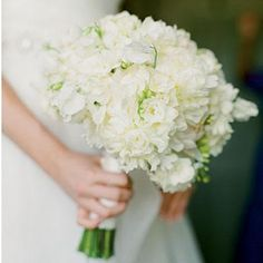All-White Bouquet | An all white mix of hydrangeas, garden roses, and gardenias is perfect for a sleek and elegant wedding. | SouthernLiving.com