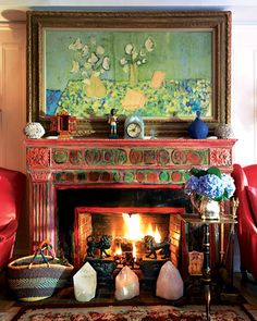 """Designer Gloria Vanderbilt: Positions large rock crystal points on hearth. I've spotted other designers (like YSL) using semi-precious """"points"""" in front of fires as well."""