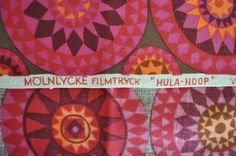 Wonderful, possibly rare, mid century modern fabric from famed Finnish textile designer Viola Grasten. Produced while she was at the Swedish textile design house and weavers Molnlycke Filmtrycke.  This medium weight woven cotton is the ideal weight for pillows, stool cover, small ottoman or chair pad. No fading and colors are vibrant throughout. The photos do not do this fabric justice. Rich brown background with bright orange and shade of bright pink and reddish purples. The repeat is…