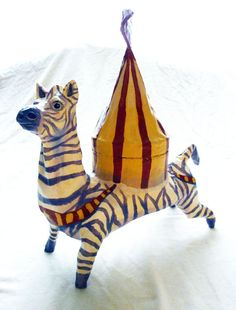 Paper Mache Zebra Toy, Circus Tent, Circus Art, Folk Art Doll, OOAK Clay Circus Zebra Container and Figurine. $60.00, via Etsy.