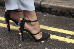 Shoes with attitude on the streets of #LFW #SS16. WGSN Street Style Shot.