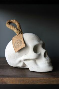 Concrete Skull Door Stop This hauntingly beautiful and ghostly door stop will add a touch of gothic to any room. Made from concrete and beautifully rendered into an elegant skull design, this door stop is unusual and eye-catching. Skull Decor, Skull Art, Art Decor, Objet Deco Design, Rockett St George, Beton Design, Gothic House, Skull And Bones, Sugar Skull