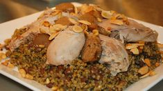 Similar to the popular dish riz a'djaj (poached chicken served on rice), this recipe uses toasted freekeh wheat with its distinctive nutty taste. The wheat is cooked slowly like a risotto with chicken stock, minced .