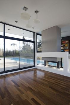 Architecture, Sliding Window Simple Modern House Design With Black And White Interior Color Decorating Ideas Plus Dark Laminate Wooden Flooring Tile ~ Grand Bell House by Andres Remy Arquitectos
