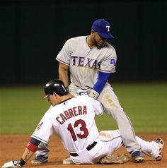 Texas Rangers' Elvis Andrus, top, tags out Cleveland Indians' Asdrubal Cabrera out at second base after Cabrera tried to steal in the sixth inning in a baseball game, Friday, May 4, 2012, in Cleveland.  (AP Photo/Tony Dejak)  game 26