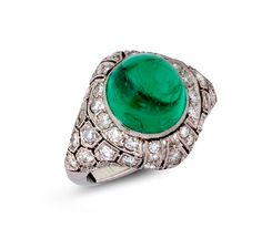 Art Deco cabochon emerald and diamond cocktail ring, the central cabochon emerald set in a diamond honey-combe bombé platinum mount