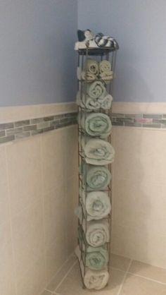 Re-purposed cd rack to bathroom towel holder in my renovated master bathroom.