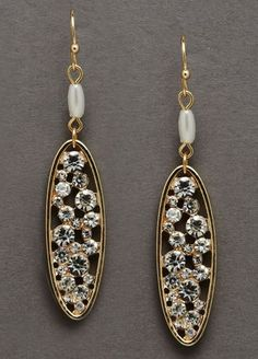 These Revello vintage style earrings are filled with crystals in between gold ovals. #davidsbridal #vintagewedding