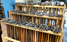 This of course is actual storage shelving made for these hammers. Don't look away however, old hammers are wonderful collectables. The well worn wood on their handles and patina on the hammer heads tell quite a story. (take a look next time)