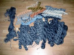 Hand spun yarns, the dark one is Gotland sheep wool from Sweden, top is hand dyed Finn sheep wool from Finland.