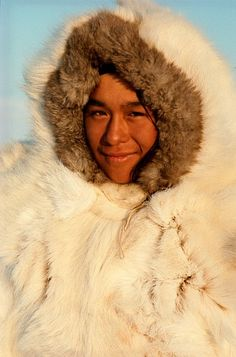 Inuit youth, Otto, wears white reindeer skin with blue fox fur trimmed hood. Siorapaluk. N.W. Greenland.: Qaanaaq, NW Greenland: Arctic & An...
