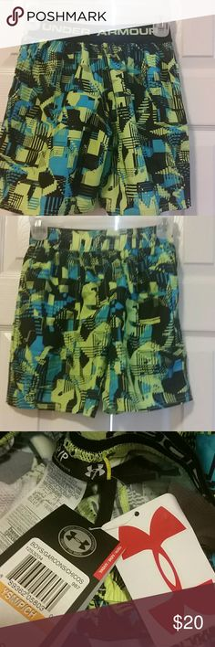 Under Armour youth small wild print sports shorts Neon yellow wild pattern heat gear loose shorts. Drawstring waist. Unlined. Mesh pockets. New with tags Under Armour Bottoms Shorts