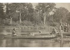 New Brunswick Mi'kmaq group with canoe, ca 1860-1870