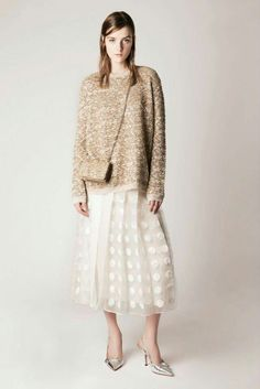 Knitted gold sweater and flowy tea lenght skirt
