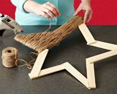 The tutorial for making this simple and beautiful twine star can be found at HOME IDEA MAKER.  Super easy because the wooden frame is made using paint sticks. Make small twine stars using craft sticks in place of the paint sticks.